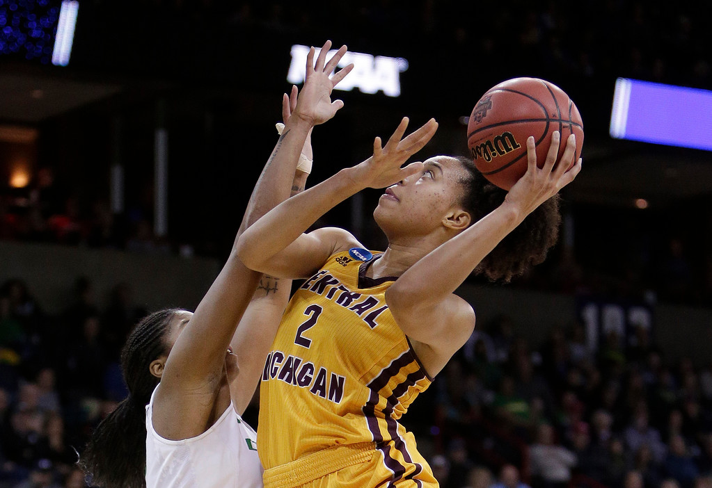 . Central Michigan forward Tinara Moore, right, shoots over Oregon forward Oti Gildon, left, during the second half in a regional semifinal at the NCAA women\'s college basketball tournament, Saturday, March 24, 2018, Spokane, Wash. Oregon won 83-69. (AP Photo/Young Kwak)
