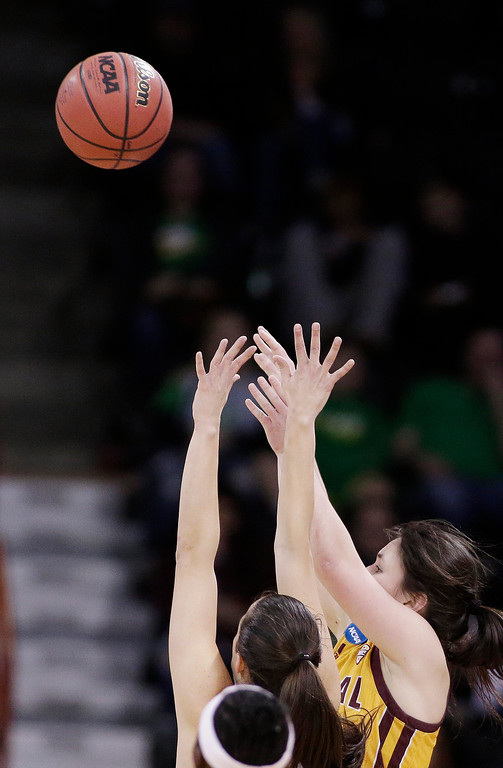 . Central Michigan guard Presley Hudson, right, shoots over Oregon guard Maite Cazorla during the second half in a regional semifinal at the NCAA women\'s college basketball tournament, Saturday, March 24, 2018, Spokane, Wash. Oregon won 83-69. (AP Photo/Young Kwak)