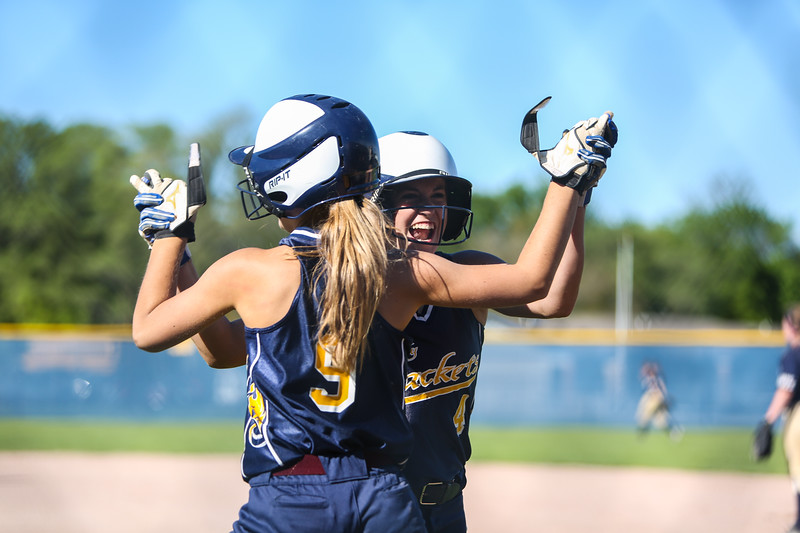 Ken Kadwell/@KenKadwell - Special to the Sun<br /> Ithaca's Brooklyn Dolloff (4) is greeted by teammate Karrigan Akin (9) after scoring a run against Shepherd in the District Final Monday, June. 1, 2015.  Final 7-1 Shepherd.