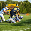 Shepherd's Blake Opdycke (28) spins out of a tackle by Gladwin defender Zachary Lask-McLemore (33) Thursday, August 25, 2016. Final 54-6 Shepherd. (PHOTOS BY KEN KADWELL -- FOR MIPREPZONE.COM).