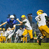 Beal City's Aaron Schafer (86) sprints past McBain's defensive line as looks to stop McBain's Logan Eling (3) from passing the ball Friday, September 30, 2016. Final 21-12 Beal City. (PHOTOS BY KEN KADWELL -- FOR MIPREPZONE.COM).
