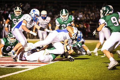 Beal City's Brett Upton (44) gets pulled down by Clare Friday, Sept. 1, 2017. Final 41-0 Clare. (PHOTOS BY KEN KADWELL -- FOR MORNINGSUN.COM).