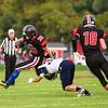 St. Louis' Dylan Weller (30) jumps over Hemlock's Mitch Engel (34) and runs the ball up to the goal line for a first down  Friday, September 16, 2016.(PHOTOS BY KEN KADWELL -- FOR MIPREPZONE.COM).