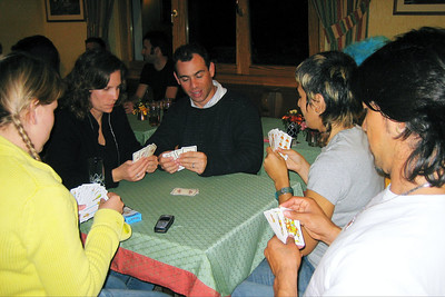 As the night progressed, everyone mixed more and some games started.  Christina Moreno-Cruz (staff Soigneur from Spain) started a card game:(from l to r) Stefanie Wiegart (staff and works for Serono in Switzerland), Carolyn Krytzer (wife of Damon, next to her), Christina, and Jorge.