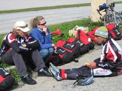 Rider leader Mark (who really was sick this day, banished to another van, like me) sits curbside with girlfriend, Rachel, and listens intently to ride leader Erik's tales of the two epic climbs conquered this day so far.
