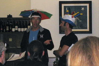More glowing eyes...ouch. Ride leader, THF Board member, and best friend of Tyler Hamilton, Chris Davenport (CO and in the umbrella hat) and Pat tell us about the ride route for the next day as well as assign riding groups.  They also predict the weather...hence the umbrella...