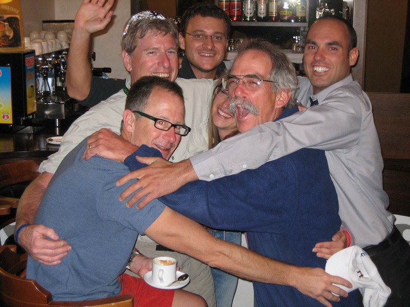 The morning after: Jimmy D., Jack, Tammy, and Bill share a group hug with the bartender and another Italian friend who stayed up all night to serve thirsty Global-ites scheduled for the 4:30 shuttle.
