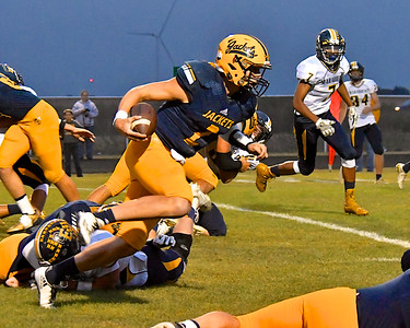 Ithaca QB Joey Bentley was named King of Homecoming and proved to be King of the game – Kayla Belles was chosen Homecoming Queen – as the Yellowjackets rolled over Ovid-Elsie 51-16 Friday, Oct. 6, 2017. (Sun photo gallery by Skip Traynor)