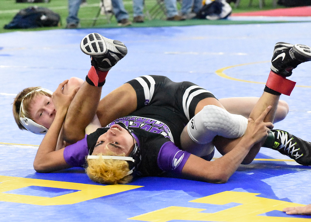 . Oxford\'s Ashton Anderson scores some near-fall points during his opening-round match against Battle Creek Lakeview\'s Armando Callejas at Ford Field in Detroit. Anderson won, 12-0, to advance to the second round. (Digital First Media photo by Jason Schmitt)