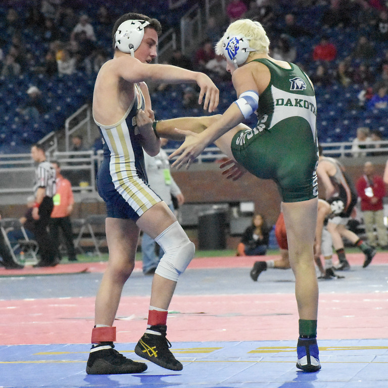 . Stoney Creek sophomore Blake Noonan (left) looks to take down Macomb Dakota\'s Brendan Ferretti in a 103-pound state semifinal match Friday at the MHSAA Individual Wrestling Finals at Ford Field in Detroit. Noonan won the match, 1-0 in an ultimate tiebreaker, to advance to the state title match on Saturday. (Digital First Media photo by Jason Schmitt)