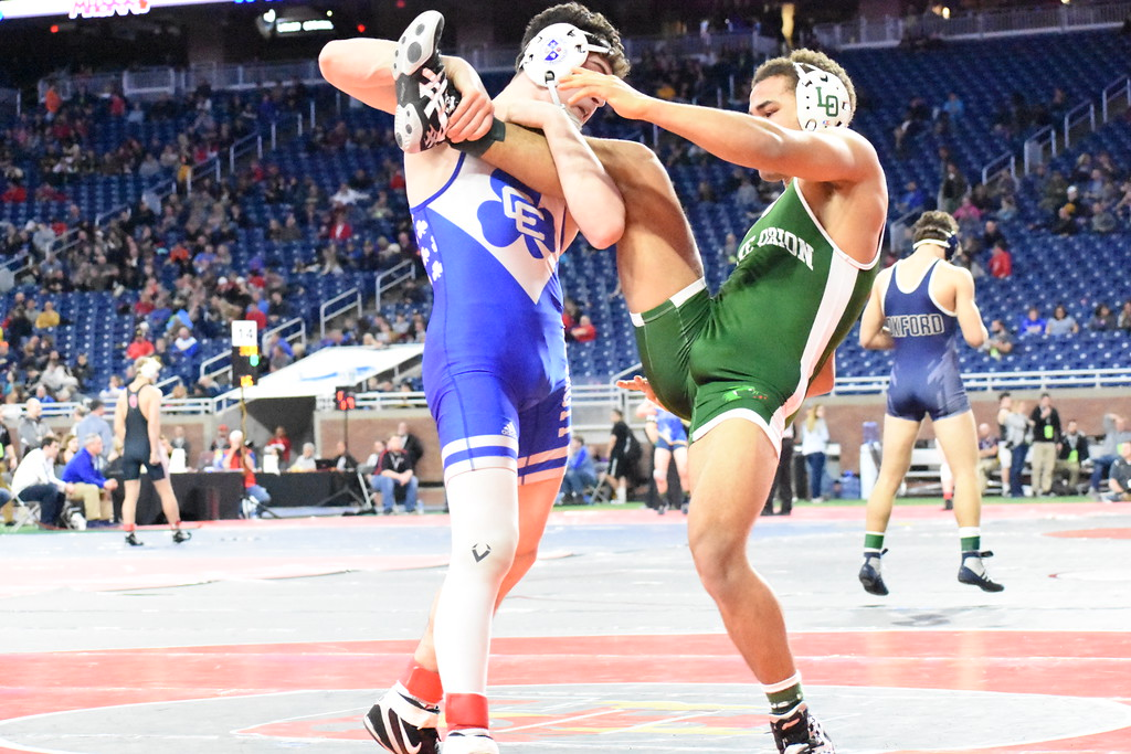 . Novi Detroit Catholic Central\'s Cameron Amine (left) and Lake Orion\'s Jaden Fisher battled in the 152-pound semifinals Friday at Ford Field. Amine pinned Fisher to move on to the Division 1 final match. (Digital First Media photo by Jason Schmitt)