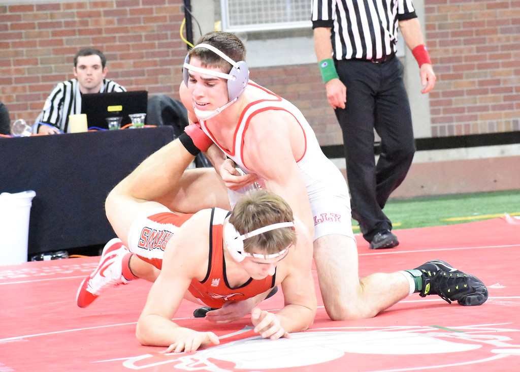 . Holly junior Cade Dallwitz (top) defeated Lowell\'s Austin Engle, 10-6, in the 171-pound semifinal in Division 2. Dallwitz will wrestle for a state title on Saturday. (Digital First Media photo by Jason Schmitt)