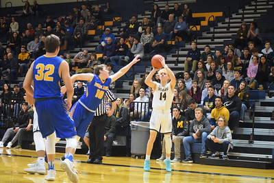 Mt. Pleasant held off Midland for a 54-52 win Friday night in SVL action at home. (Sun Photos by JIM LAHDE)