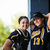 Mt. Pleasant's Hannah Carson, left, and Oaklie Mogg pose for a photo in the dugout against Davison Monday, May. 15, 2017. (PHOTOS BY KEN KADWELL -- FOR MIPREPZONE.COM
