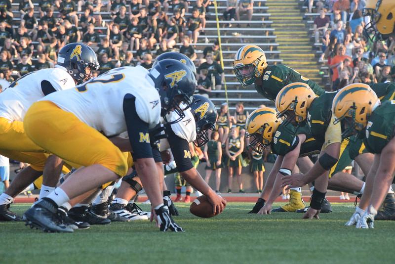 Mt. Pleasant fell in its SVL opener in Midland Thursday by a final of 41-14. (Photos by JIM LAHDE -- MIPREPZONE.COM)
