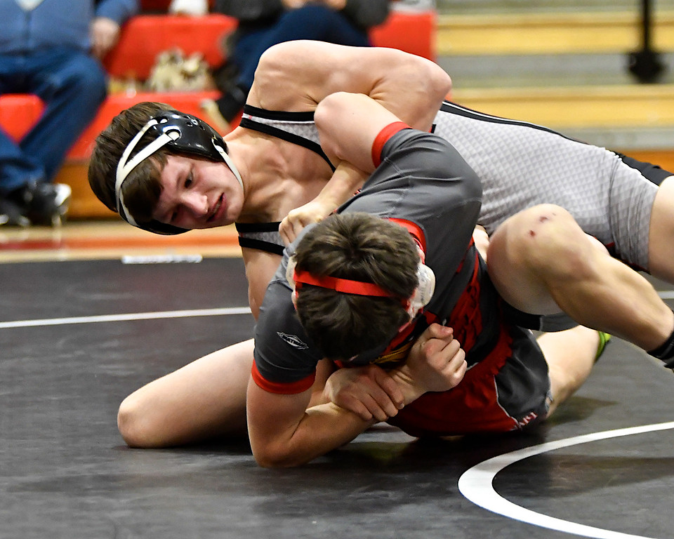 . St. Louis senior Ernie Diaz scored his 150th win and St. Louis took two team wins in the Sharks� home conference quadrangular meet to run their record to 11-5 on Parents� Night Wednesday, Jan. 24, 2018. (Sun photo gallery by Skip Traynor)