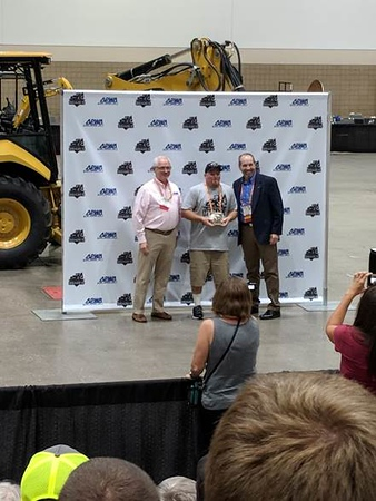 Bobby Bond Jr. accepting his 2nd place award for the backhoe and Mini Excavator