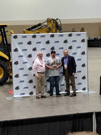 John Brown accepting his 3rd place award for the Skid Steer competition.