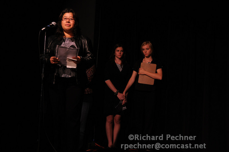 Rosa Alegria thanking those attending the Benefit Soiree for her daughter, Anna, as emcees Rosie Fry (TA'10) and Devon Clary (TA'11) look on