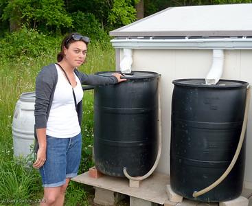 Tamara showing the Rainwater Catchment System. 20090705-Kavanah Garden-19