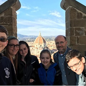 At the top of the Palazzo Vecchio tower, showing Brunelleschi's dome in the background. Tomorrow morning, we're climbing to the top!