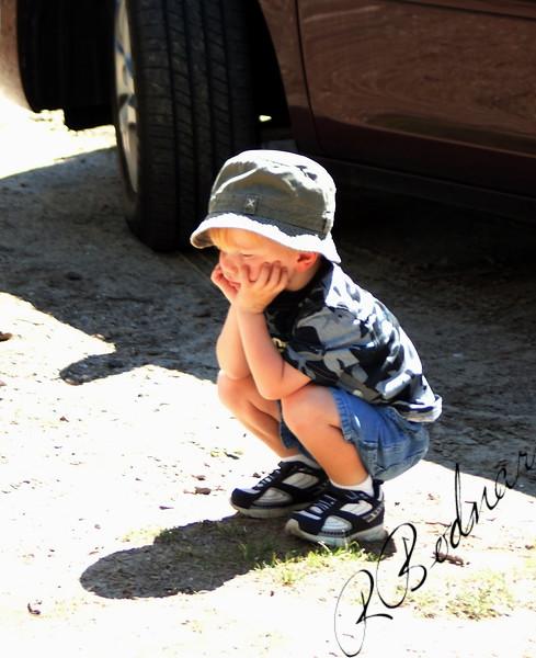 Photo By Bob Bodnar.....................................Bored, Cute little Boy...