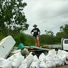 Toni astride the Rubbish Mountain we had collected