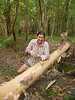 Toni, debarking a tree to be used for the bridge over the creek