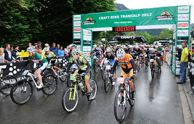 Start of the 2012 CRAFT BIKE TRANSALP  First stage leads over 97.80 km and 2,215 meters in elevation from Oberammergau, Germany, to Imst, Austria  Sally Bigham (GBR) of Topeak Ergon Racing in the middle, Milena Landwing (SUI) of Centurion-Vaude on the right  © Craft Bike Transalp/Peter Musch