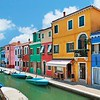 colorful houses by the water canal at the island Burano near venice, Italy