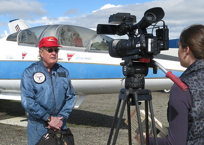 KSBY  reporter interviewing George Marrett who is giving her background about Dick Rutan's accomplishments