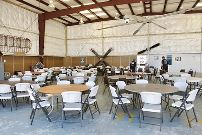 Carol Verstuyft starting to set up tables for Friday night's Barn Dance festivities.  Almost 200 people will be in attendance