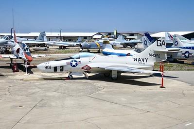 """The F-9 Korean era """"Cougar"""" in position as the backdrop for the car show entrant photos"""