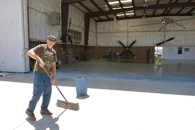 Bob Kelly hard at working cleaning up the apron in front of Hanger 1