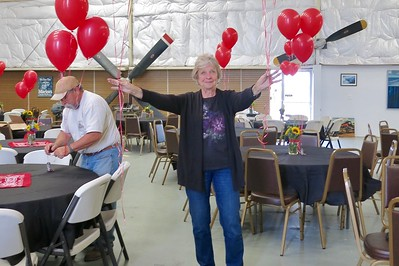 Carol Verstuyft finishing up the final touches for Friday night's dinner and Barn Dance featuring Monte Mills