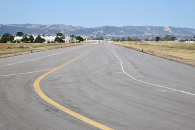 """Wayne Bloechl was out early this morning marking off the locations for swap meet participants  to set up their wares on taxiway """"F"""""""