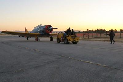 Meanwhile.... Scott Stelzle and his son move the airplanes to their location on the taxiway