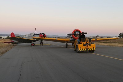 Scott has positioned the Vultee BT-13  and is placing the SNJ-5  to close this entire section of the taxiway  to active airport aviation traffic