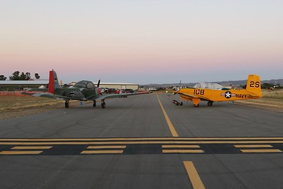 """The Focke-Wulf 149 and T-34 are positioned to block off taxiway """"foxtrot"""" on its east end from  active runway 31"""