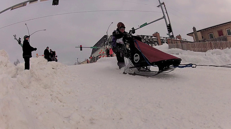 Outbound on Cordova Hill on day 1 of the Rondy Open World Championship Sled Dog Race in Anchroage, Alaska.<br /> <br /> NOTE: This video has been slowed down to show the mushers how their dogs are performing.