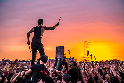Twenty One Pilots surfing at sunset in Argentina