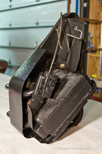 Heater box partially assembled with defrost flapper in place. Thick side of the bumper button is mounted down on the flapper (down when oriented correctly) so it quiets the clang when defrost is switched to on position.