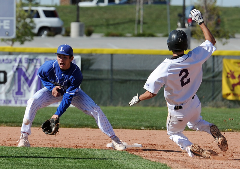 Mountain View's #2 Locke Bernhardt slides int second as Longmont's #7 Andrew Kavan catches the ball Monday, May 2, 2016, at Mountain View High School in Loveland. (Photo by Jenny Sparks/Loveland Reporter-Herald)