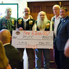 Ricci Ruschioni and Fire and Iron MC, Station 857 donate a $2,900 check during Montachusett Veterans Outreach Center's 35th anniversary celebration at the Colonial Hotel in Gardner on Wednesday evening. SENTINEL & ENTERPRISE / Ashley Green