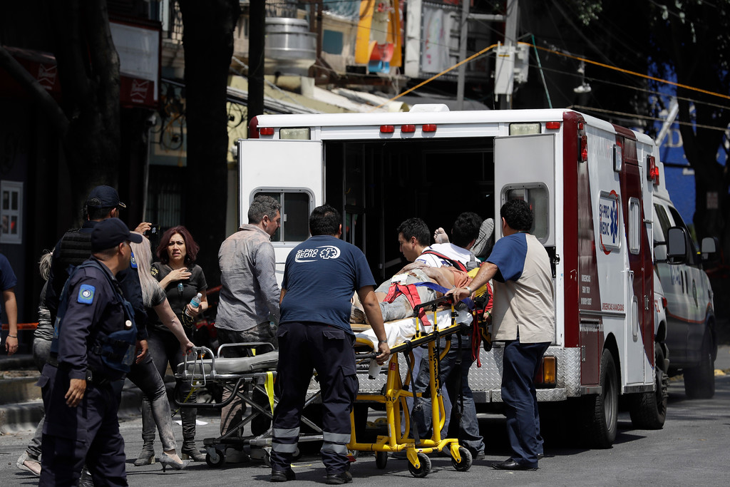 . An injured person is put in an ambulance in Mexico City, Tuesday, Sept. 19, 2017. A powerful earthquake jolted central Mexico on Tuesday, causing buildings to sway sickeningly in the capital on the anniversary of a 1985 quake that did major damage. (AP Photo/Rebecca Blackwell)