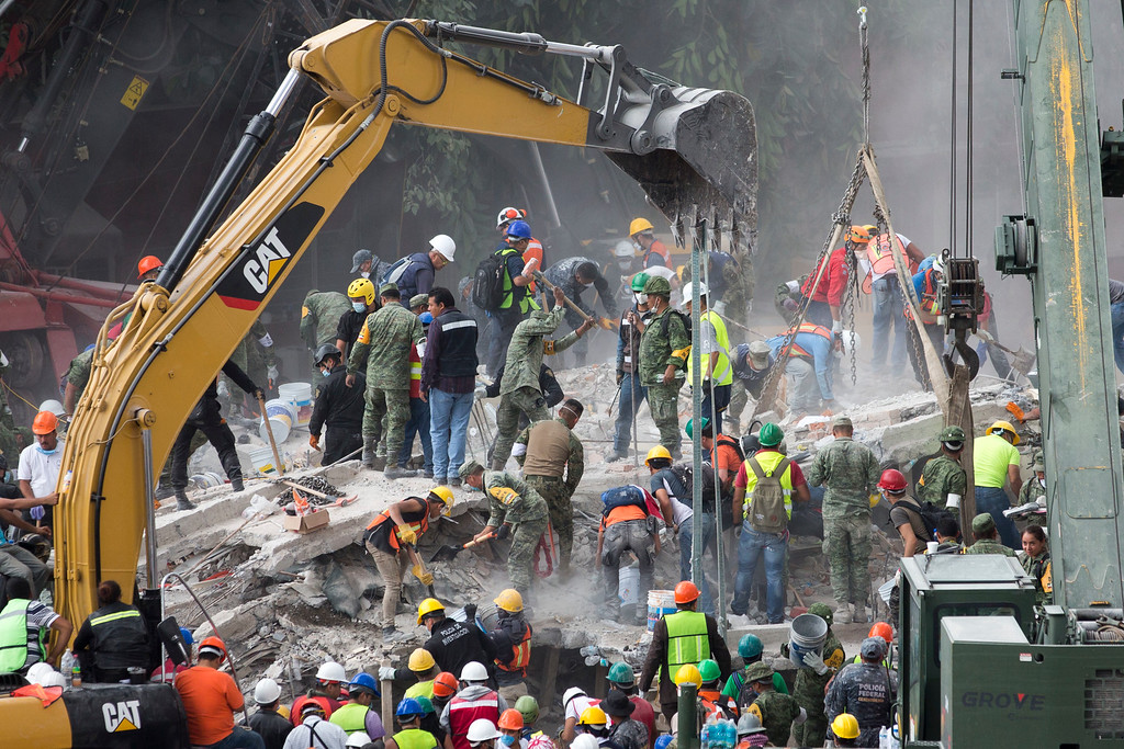 . Rescue personnel work on a collapsed building, a day after a devastating 7.1 earthquake, in the Del Valle neighborhood of Mexico City, Wednesday, Sept. 20, 2107. Efforts continue at the scenes of dozens of collapsed buildings, where firefighters, police, soldiers and civilians continue their search to reach the living. (AP Photo/Moises Castillo)