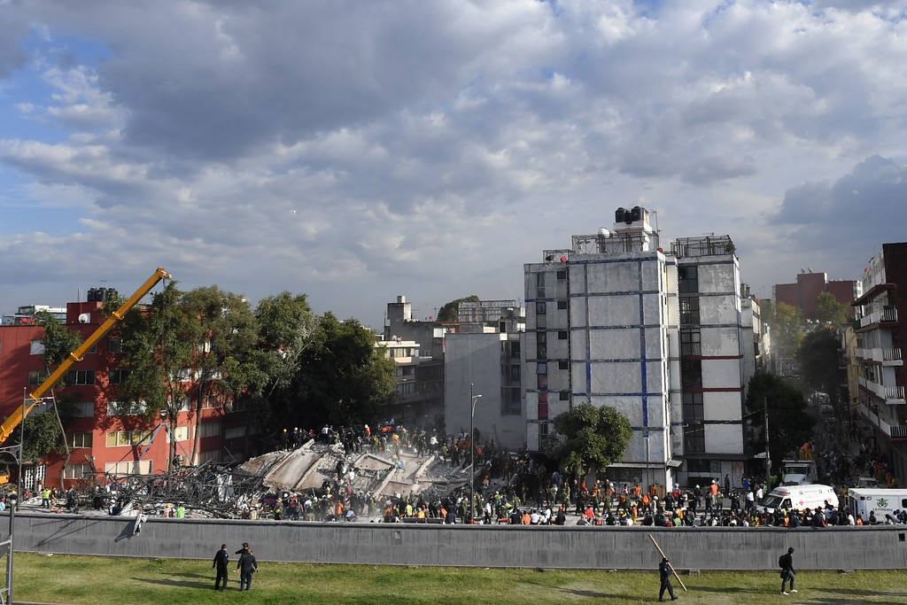 . Rescuers, firefighters, policemen, soldiers and volunteers remove rubble and debris from a flattened building in search of survivors after a powerful quake in Mexico City on September 19, 2017. A devastating quake in Mexico on Tuesday killed more than 100 people, according to official tallies, with a preliminary 30 deaths recorded in the capital where rescue efforts were still going on. (YURI CORTEZ/AFP/Getty Images)