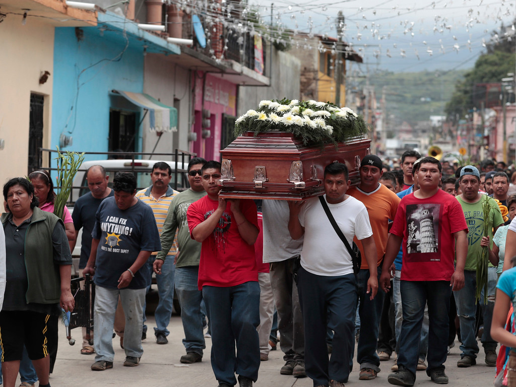 . Locals carry the casket of a woman who died in Tuesday\'s earthquake, in Tlayacapan, Morelos state, Mexico, Wednesday, Sept. 20, 2017. People by the millions rushed from homes and offices across central Mexico after a 7.1 earthquake, sometimes watching as buildings they had just fled fell behind them with an eruption of dust and debris. (AP Photo/Eduardo Verdugo)