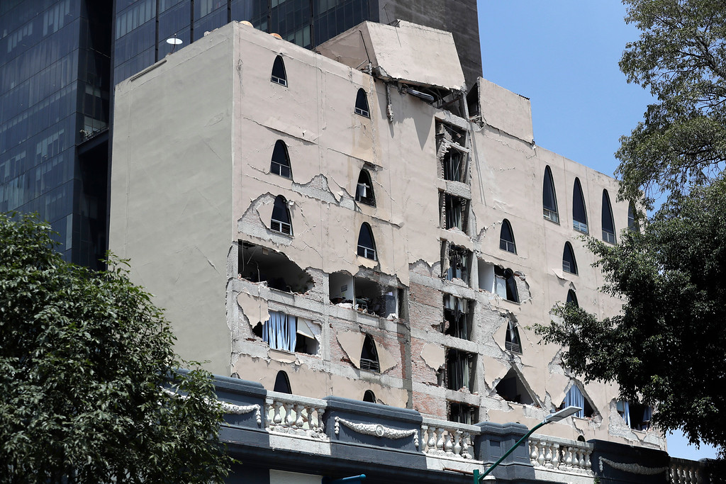 . Remains of a damaged building stands after an earthquake in Mexico City, Tuesday, Sept. 19, 2017. A powerful earthquake has jolted Mexico, causing buildings to sway sickeningly in the capital on the anniversary of a 1985 quake that did major damage. (AP Photo/Rebecca Blackwell)