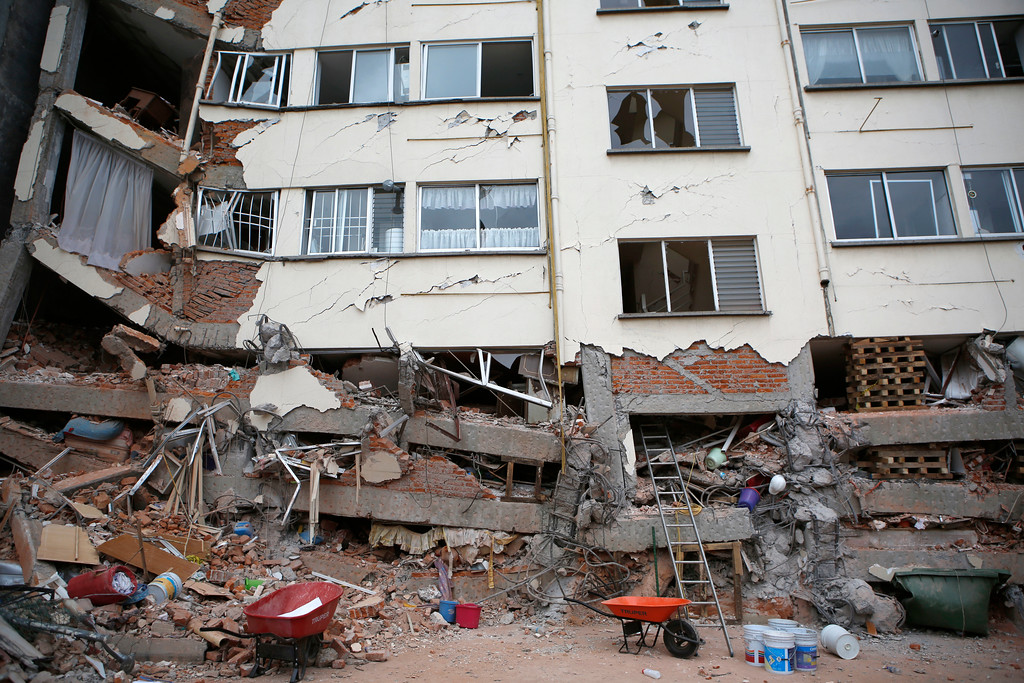 . An earthquake damaged building stands in the Linda Vista neighborhood of Mexico City, Wednesday, Sept. 20, 2017. People by the millions rushed from homes and offices across central Mexico, after a 7.1 earthquake, sometimes watching as buildings they had just fled fell behind them with an eruption of dust and debris. (AP Photo/Rebecca Blackwell)
